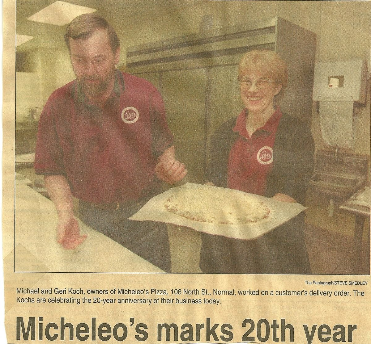 Mike & Geri Koch, owners of Micheleo's Pizza, working on a customer's delivery order.